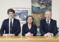 Picture of funerals organisation team at Feehily's. Links to contact page.